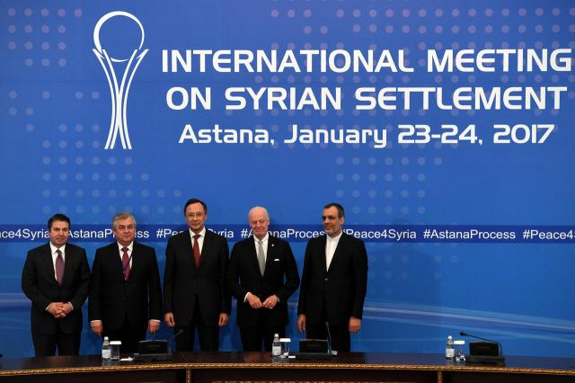 From L: Turkish Foreign Ministry Deputy Undersecretary Sedat Onal, Russia's special envoy on Syria Alexander Lavrentiev, Kazakh Foreign Minister Kairat Abdrakhmanov, UN Syria envoy Staffan de Mistura and Iran's Deputy Foreign Minister Hossein Jaber Ansari pose after the announcement of a final statement following Syria peace talks in Astana on January 24, 2017. / AFP PHOTO / Kirill KUDRYAVTSEV