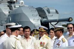 Philippine President Rodrigo Duterte (3rd L) talks to Russia's Rear Admiral Eduard Mikhailov (4th R) at the anti-submarine navy ship Admiral Tributs at the south pier in Metro Manila, Philippines January 6, 2017. REUTERS/Noel Celis/Pool