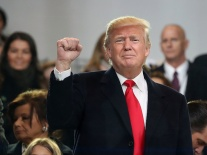 WASHINGTON, DC - JANUARY 20: U.S. President Donald Trump waves to the crowd from the inaugural parade revieing stand in front of the White House on January 20, 2017 in Washington, DC. Donald Trump was sworn in as the nation's 45th president today. (Photo by Mark Wilson/Getty Images)
